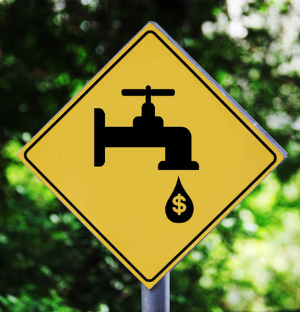Yellow traffic label with leaking faucet pictogram photo