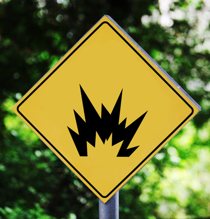 Yellow traffic label with explosion pictogram photo