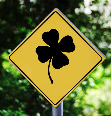 Yellow traffic label with clover pictogram photo