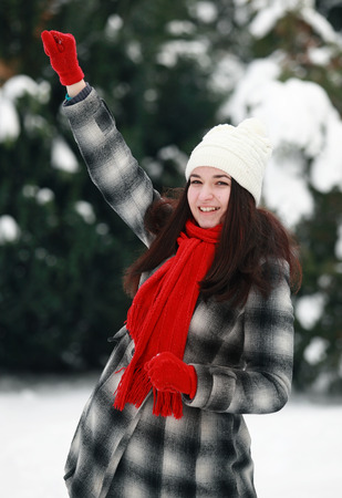 prepare: Young woman prepare throwing snowball