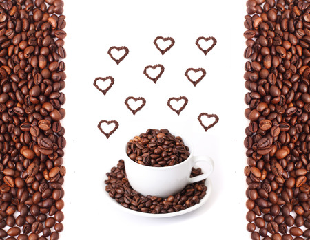Coffee mug full of coffee beans with heart shapes photo