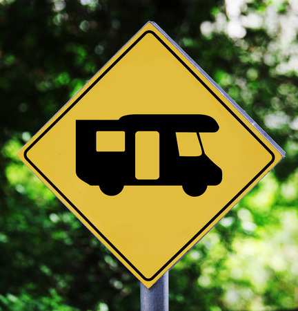 Yellow traffic label with camping bus pictogram photo
