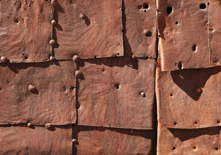 Rusty damaged iron sheets with rivets photo