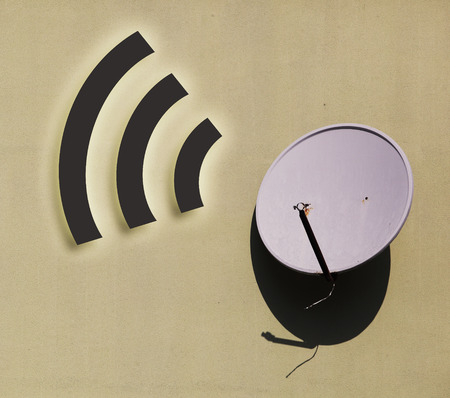 parabolic mirror: Television satellite dish against with wifi sign