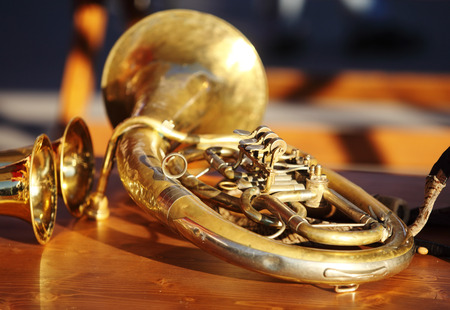 Blowing brass wind instrument on table