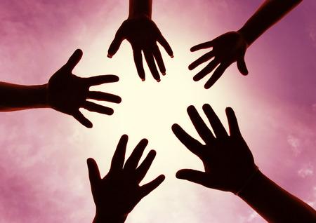 necromancy: Five hands symbol of union touch white light Stock Photo