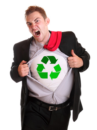 Young angry businessman tearing his shirt - dollar recycling symbol on it photo