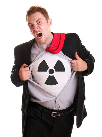 t off: Young angry businessman tearing his shirt - dollar radioactive symbol on it