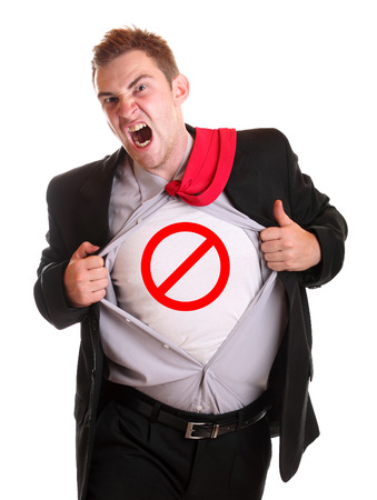 Young angry businessman tearing his shirt - dollar traffic symbol on it photo