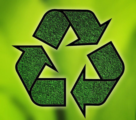 Recycling symbol made of grass photo