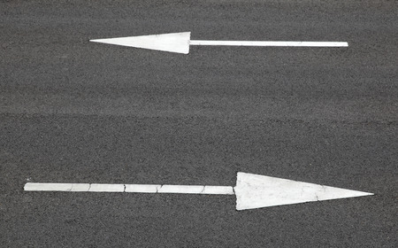 Road sign, arrow pointing two way photo