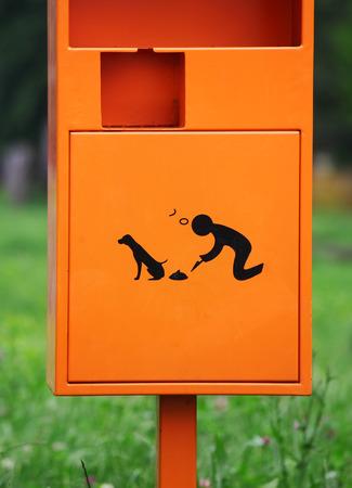Orange dog waste bin outdoor photo