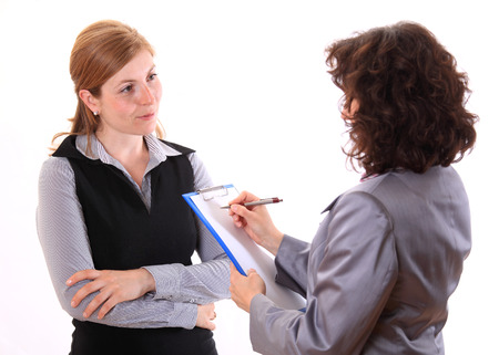 Woman making notes at job interview Archivio Fotografico