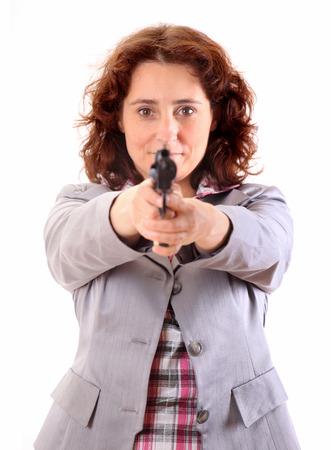 mujer con arma: Belleza de la mujer de negocios joven con el arma