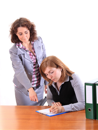 Boss woman dictating to her assistant
