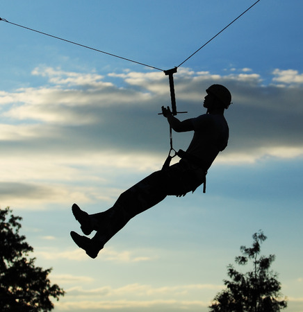 alpinist: Silhouette of alpinist hang on rope Stock Photo