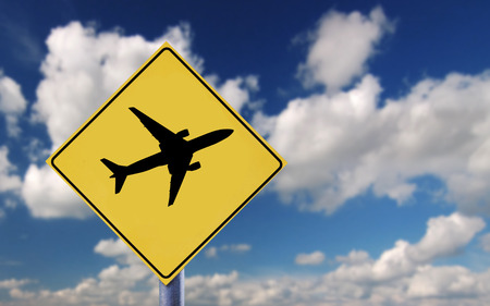 Blue sky clouds and airplane symbol photo