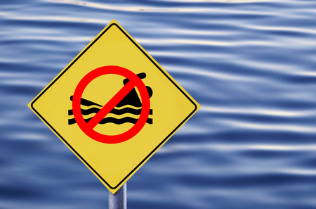 no swimming: No swimming allowed in water label Stock Photo