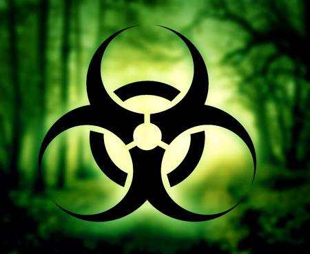 riesgo biologico: S�mbolo del Biohazard con bosque brillante Foto de archivo