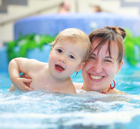 child bath: Lovely mother with her child in swimmingpool