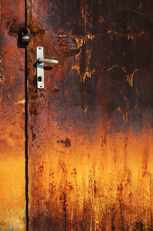 oxidated: Old rusted door with padlock