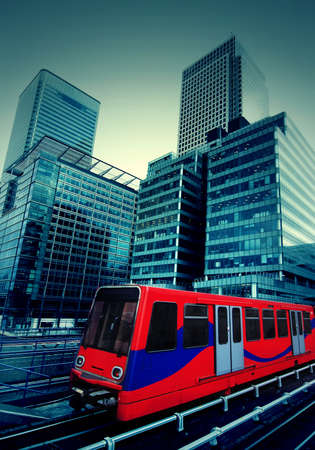 urban transport: Canary Wharf in London with train