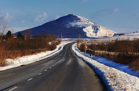 Road with mountain scene in winter