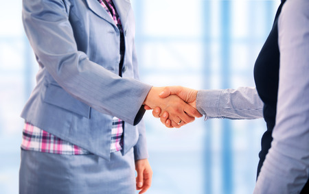 Two women give handshake after agreement Stockfoto