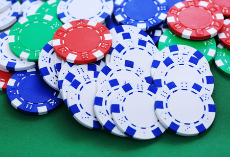 tokens: Colorful tokens in casino on green background Stock Photo