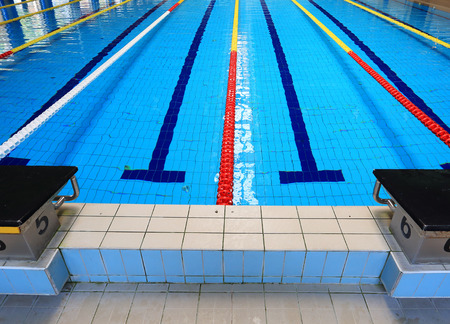 swimming to float: Edge of Sports swimming pool Stock Photo