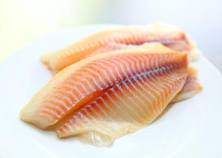 tilapiini: Raw salmon on white background Stock Photo