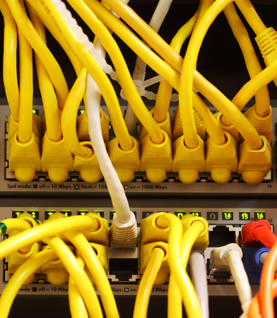 switches: Modern network switches with cables Stock Photo