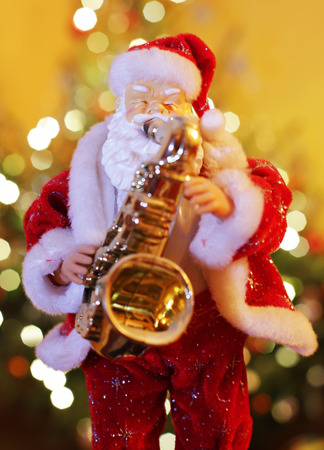 winter blues: Santa Claus figurine playing music on saxophone Stock Photo