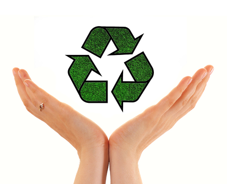 recycling symbol: Hands of woman holding paper house with recycling symbol