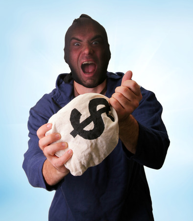 heist: Masked bank robber with money sack Stock Photo