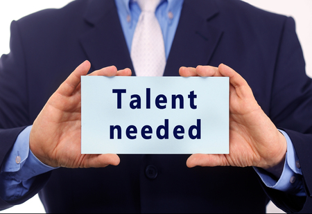 needed: Business man hold paper talent needed text on it
