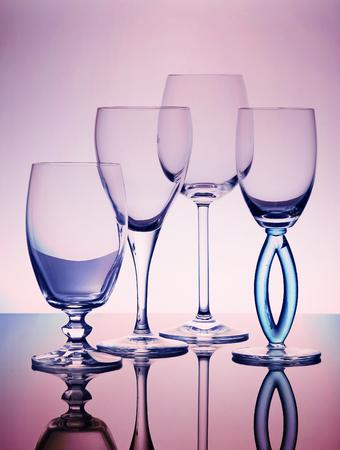 cup four: Four empty wine glasses transparent composition Stock Photo