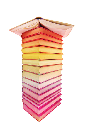 Tower of colorful book in. Isolated on white