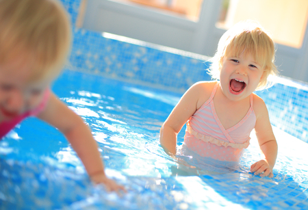 children at play: Happy children play in swimming pool