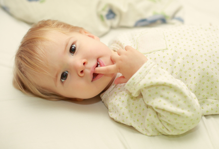 Cute adorable young child in bed Stock Photo