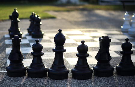 Huge outdoor chess figures on floor Stock Photo