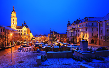 PECS, HUNGARY - DECEMBER 19: Pecs, Szechenyi Square with the advent christmas market at night in panorama view, December 19, 2016 in Pecs, Hungary.