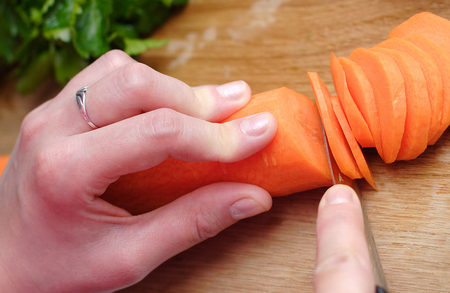 Housewife prepares healthy vegatable carrot to cooking