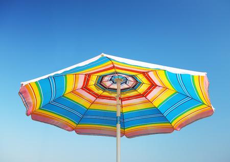 Detail of beach parasol at blue sky