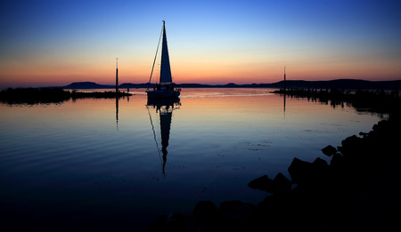 Sailing boats on Lake Balaton at sunset