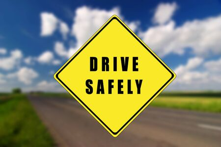 Empty road with yellow traffic sign, with drive safely text