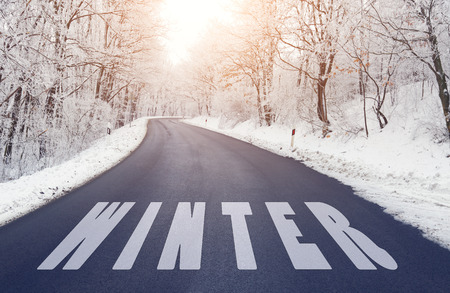 Empty road in winter with winter text