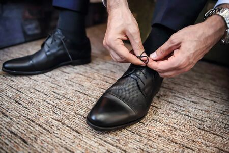 Business man knot shoe lace indoor
