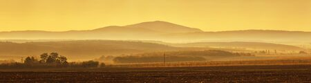 Beautiful foggy landscape in panorama view in the morning hours