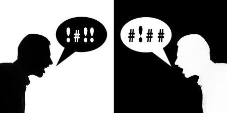 Two silhouette man quarrel each othet, bubble text Banco de Imagens